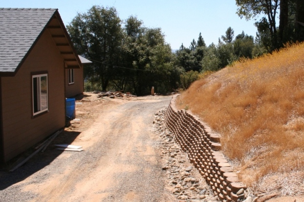 House, driveway, wall and slope