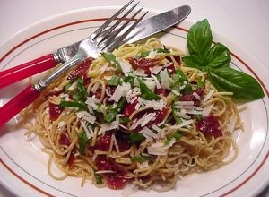 Whole wheat pasta with oven-dried cherry tomatoes, basil ribbons, and grated Pecorino Romano cheese. Divine!