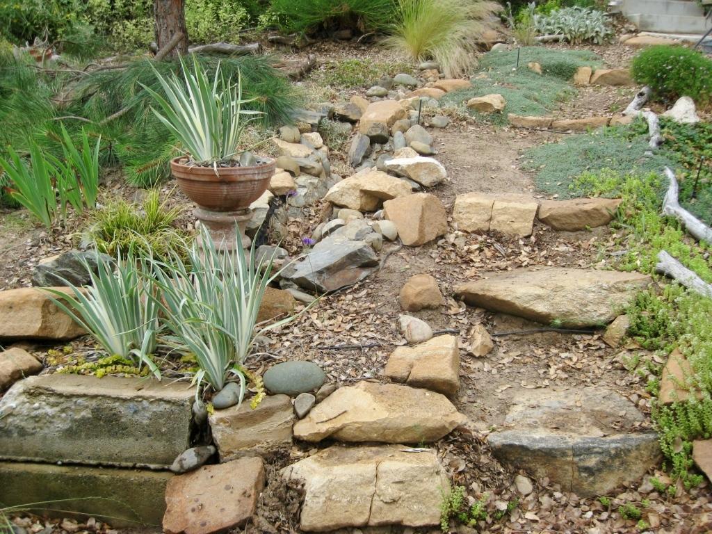 2010 June- Steps built from indiginous rock form a sort of rock garden