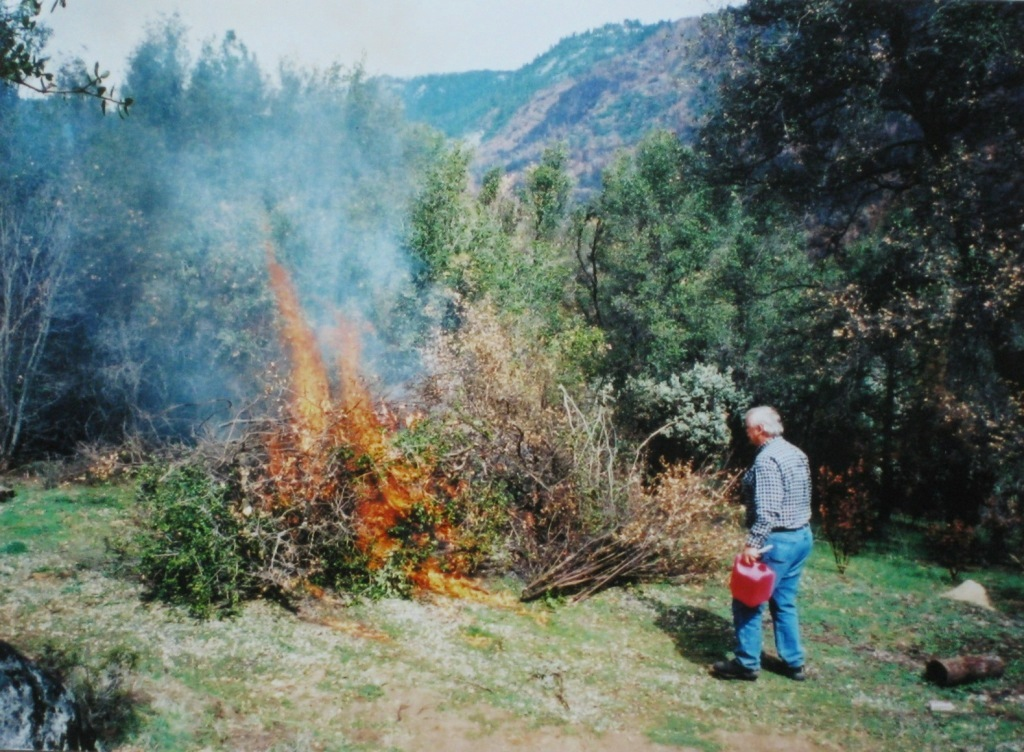 First burn pile and we start brushing out the property