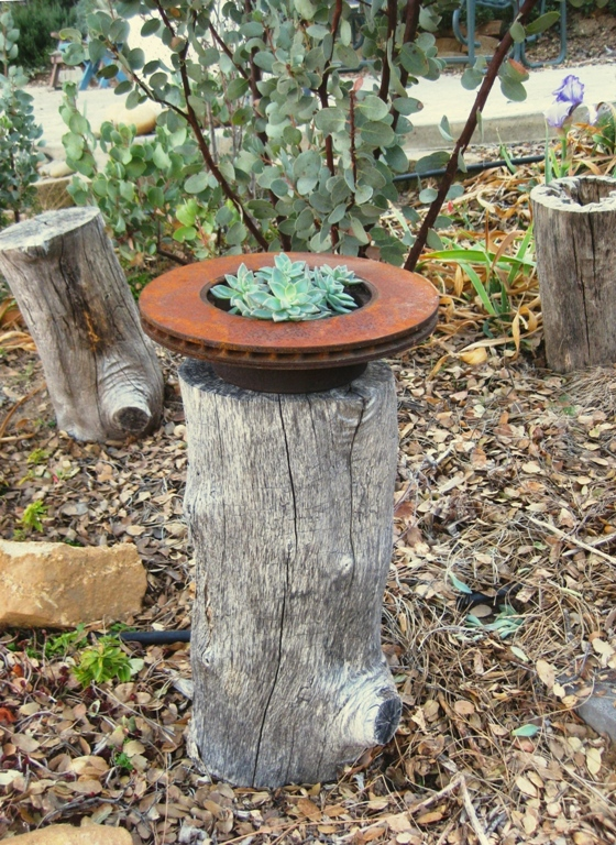Rusty brake 'container' on log