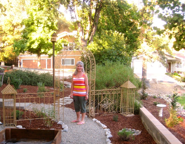 Barbara by the ornate side arbor, perfect for the spot